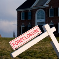 Banks Dodge Expected Wave of Foreclosures