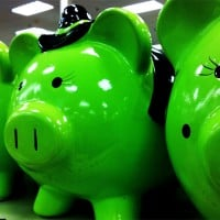piggy banks 200x200 HSBC Slashes 14K More Jobs