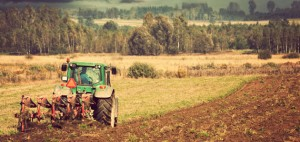 14371267 tractor in field 300x142 Whats In the $1 Trillion Farm Bill?