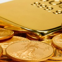 14757090 gold ingot and coins 200x200 Gold Futures Hit Six Week Low as Dollar Rises