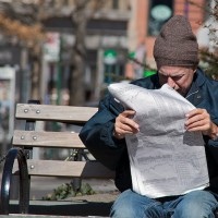 man on bench looking at stock prices newspaper 630 200x200 175 Year Old Paper Quits Daily Publishing