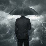 storm rain umbrella businessman 630 ISP