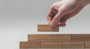 Golub Capital BDC is a business development company (BDC), represented by an image of a person stacking blocks together