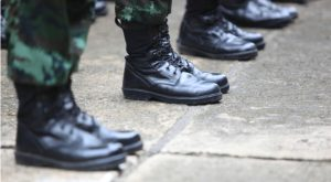 Image of soldier's feet dressed with combat boots