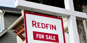 The redfin logo displayed on a for sale sign