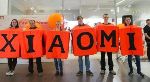 coworkers holding on to letters to spell Xiaomi