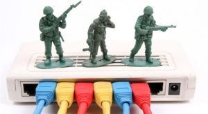 toy soliders standing on top of a router