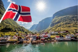 The Norwegian flag with a beautiful landscape in the background