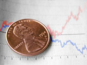 Penny Stocks: A penny sitting on a chart with two trend lines on top