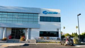 Zscaler (ZS) logo on building with parking lot in foreground
