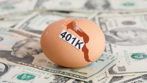 A Broken Egg With 401K Tag Sit on a Pile of Money