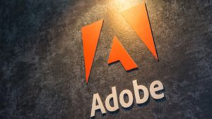 Adobe (ADBE) logo on wall of corporate building.