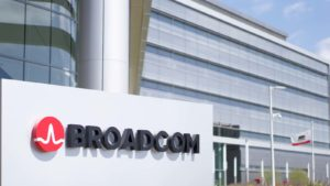 broadcom (AVGO) logo outside office building representing 5g stocks