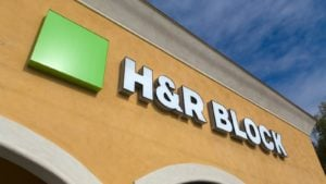 Image of a yellow building featuring the H&R Block (HRB) logo