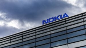 Dark clouds over Nokia (NOK) brand name on top of a building in Helsinki, Finland