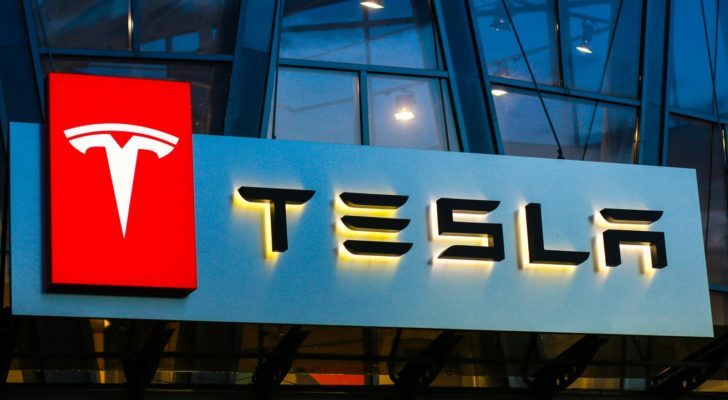 Tesla (TSLA) logo on city building at night