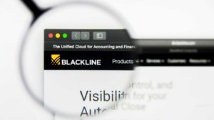 A magnifying glass zooms in on the website of BlackLine (BL).