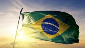 The Brazilian flag with the sun in the background