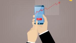 image of mobile phonw with stock chart on screen. sleeper stocks to buy