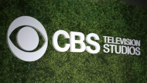 the CBS logo featured on a textured green background
