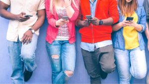Group of friends watching smart mobile phones