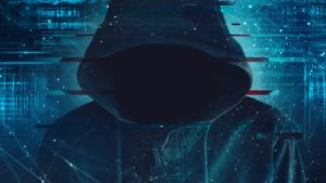 a faceless figure wearing a hoodie surrounded by lines of code