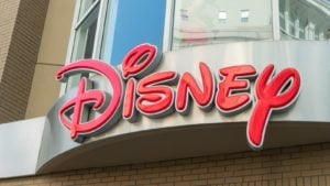 the Disney logo in red font on a storefront