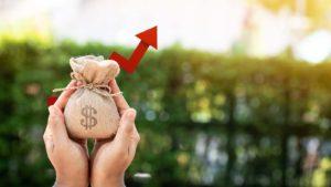 image of hands holding small money bag symbolizing dividend stocks