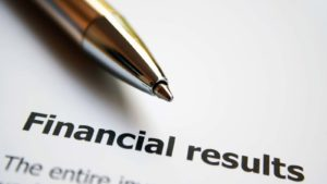 Image of a pen over top of the words financial results.