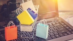 Image of small shopping bags sitting in a shopping cart on a computer