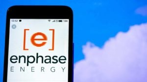 mobile phone screen with enphase energy logo on it to represent renewable energy stocks