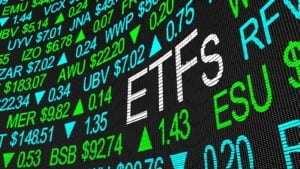 "A stock market ticker tape that reads ""ETFs."" representing best etfs"