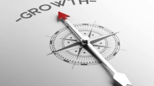 compass with an arrow pointing toward growth to represent growth stocks