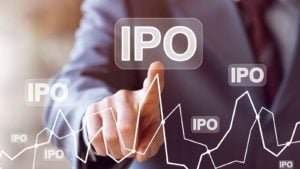 "A hand touches a digital chart with the text ""IPO."""