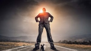 a giant businessman standing in the middle of the road towering over a smaller, cowardly business man