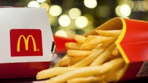 A McDonald's (MCD) burger box and fries rest on a flat surface.