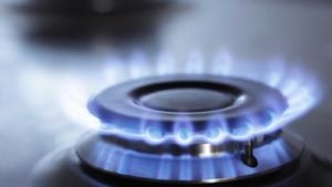 Image of a gas burner with a blue flame