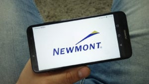 Newmont (NEM) logo on a mobile phone screen