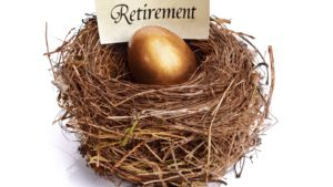 """a golden egg in a nest with a label reading """"Retirement"""". retirement investments"""