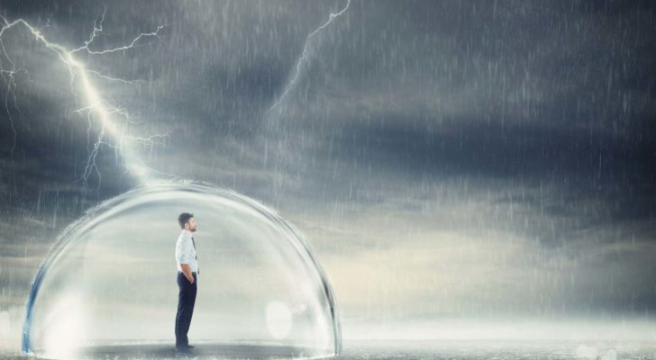 man in bubble outdoors protected from a dark storm, rain and lightning