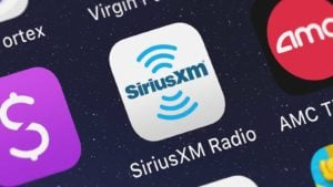 The Sirius XM (SIRI) mobile app logo on a smartphone screen. cheap stocks