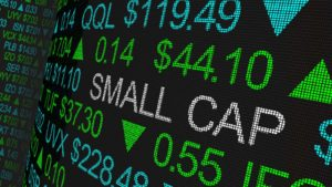 "a ticker board that says ""SMALL CAP"" among various ticker increases. represents small-cap stocks to buy"