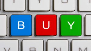 BUY spelled out on a computer keyboard representing stocks to buy
