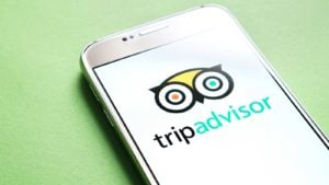 image of mobile phone screen displaying tripadvisor logo (TRIP)