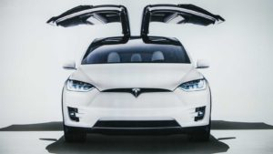 white tesla car (TSLA)