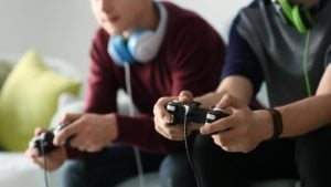 Image of two boys playing video games