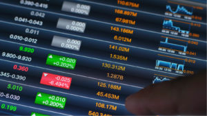 Stock market numbers and financial data displayed on trading screen of online investing platform.