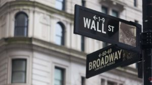A close-up shot of the Wall Street street sign.