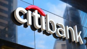 Citigroup (C) logo on a sign outdoors.