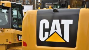 The back of a Caterpillar (CAT) work vehicle displaying company logo